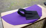 This purple panel came from Galco's Pax purse. It shows how Galco's sewn-in elastic pouch secures the firearm with a