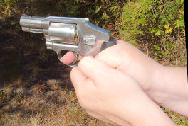 A thumbs locked down grip on a revolver
