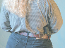Canted leather IWB holster carried behind hip. Image courtesy Gila Hayes, www.firearmsacademy.com