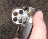 Visual illustration of how an 'unloaded' revolver can still be loaded. Always, always, always double check by counting the holes.