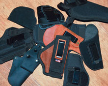 This modest pile of inexpensive holsters that simply don't carry the gun securely or fit it well cost a cumulative total of around $200—roughly the same cost as an excellent belt and a custom-made holster from an established holstermaker.