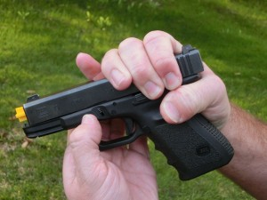 With the gun still pointed in a safe direction, pull down on the takedown levers until you feel the slide release.