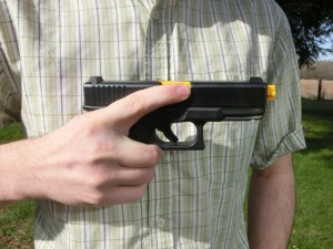 Placing the finger high on the gun's frame, at the natural limit of movement, ensures that it won't slip onto the trigger if the shooter slips and falls.