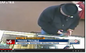 What bad gunhandling habit do you see in this still from a surveillance video?